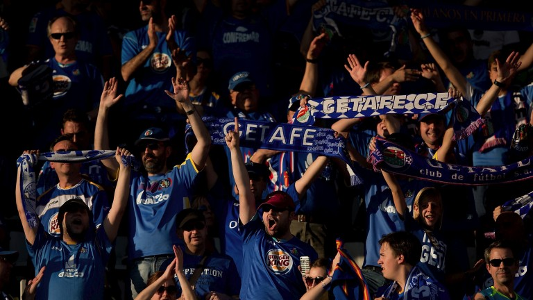 Getafe fans cheer their team