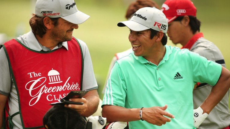 Andres Romero talks with his caddie