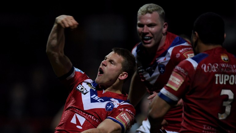 Jacob Miller of Wakefield celebrates after scoring a try against Leigh
