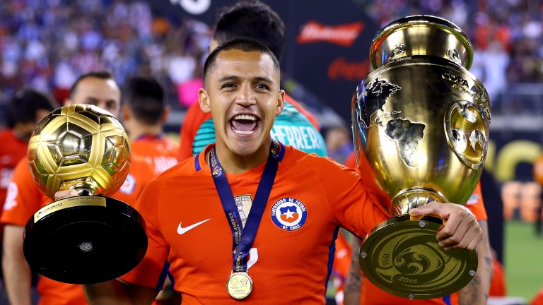 Alexis Sanchez celebrates after Chile beat Argentina on penalties to retain Copa America