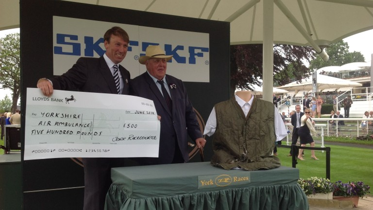 Mick Easterby is presented with a cheque for £500 in exchange for his jacket