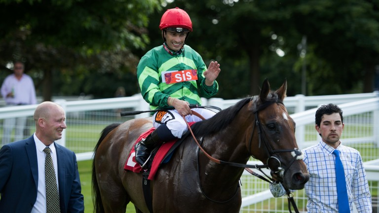 All smiles: Silvestre de Sousa is beaming after bringing up his hat-trick on Call Me Grumpy. And he completed a four-timer in the next race on Shargiah, landing the first four races on the card