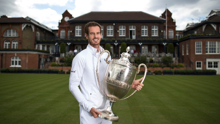 Andy Murray of Great Britain poses with the Queen's Club trophy