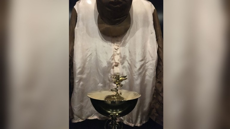Sir Winston Churchill's racing silks and the Aly Khan Memorial Trophy, both on display in Newmarket
