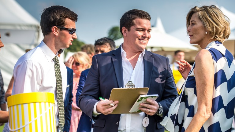 Chris McAnulty (centre) signs the docket for top lot Lockheed at £900,000