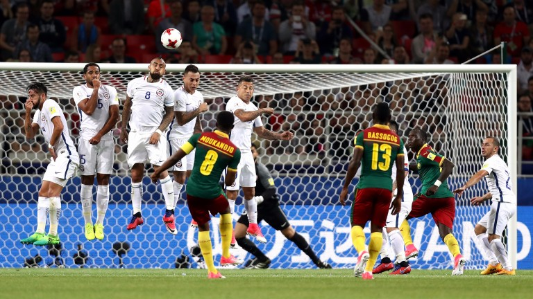 Benjamin Moukandjo hits a free kick for Cameroon during their 2-0 defeat to Chile