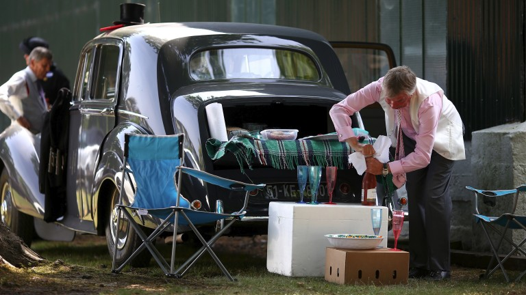 Perfect preparation: racegoers enjoy a picnic in the car park before racing