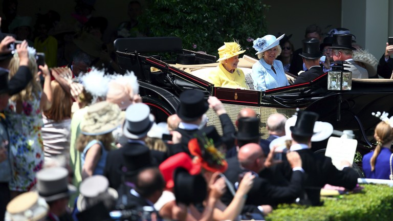 The Queen, who dashed from the state opening of Parliament, arrives with Prince Charles and the Duchess of Cornwall
