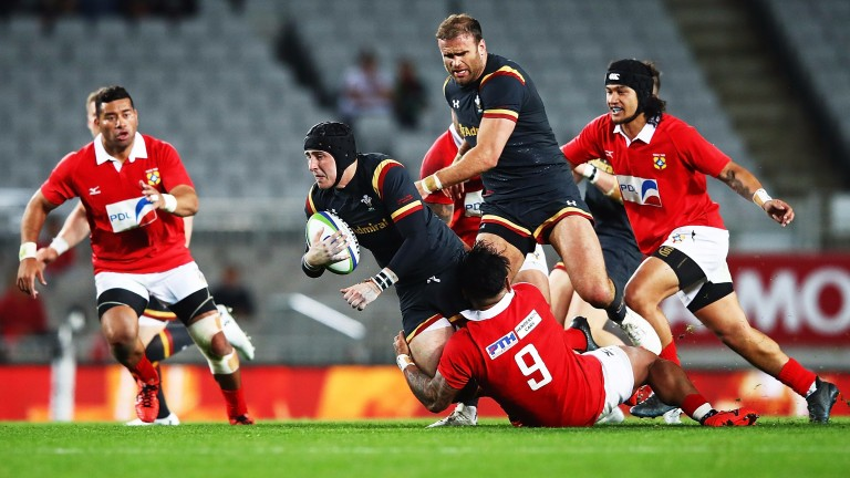 Sam Davies is tackled as he tries to make a break against Tonga