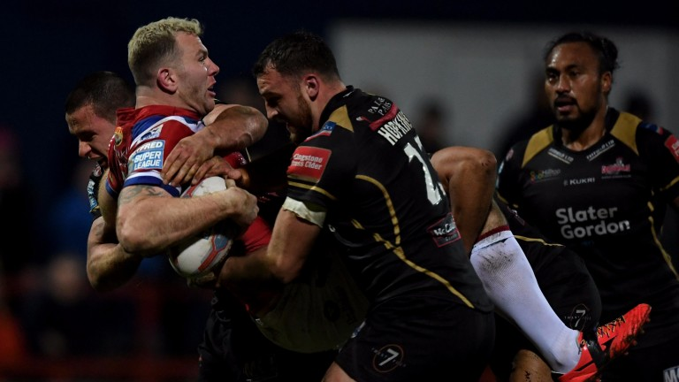 Leigh's Sam Hopkins gets stuck into Keegan Hirst of Wakefield