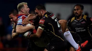 Leigh's Sam Hopkins gets stuck into Keegan Hirst of Wakefield
