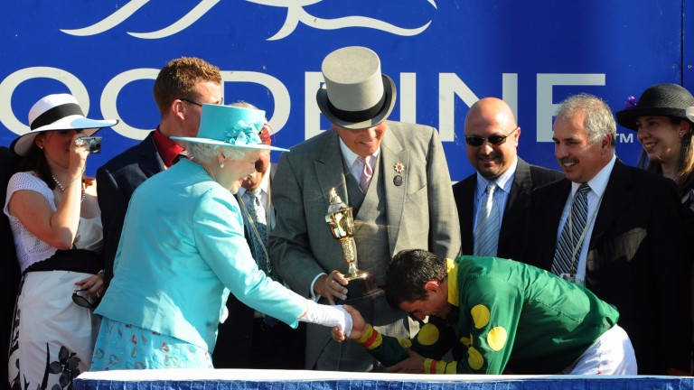 The Queen presents Eurico Rosa Da Silva with the Queen's Plate at Woodbine in 2010.