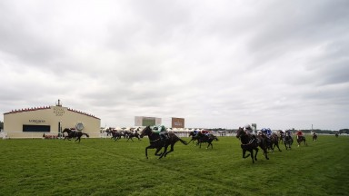 Sioux Nation (Ryan Moore, far side) and Santry are separated by the width of the course at the end of the Norfolk Stakes