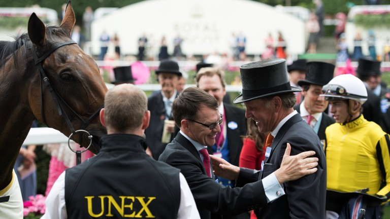 Gracious in defeat: Aidan O'Brien congratulates winning trainer Michael Bell after the brilliant Big Orange triumphs in the Gold Cup