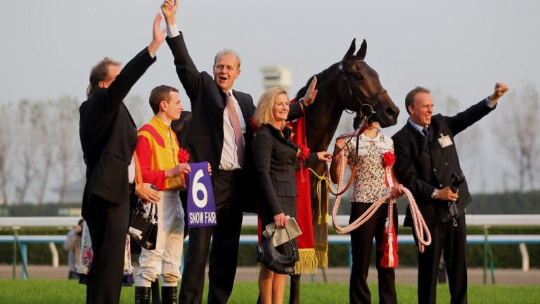 Ryan Moore, Ed Dunlop and Snow Fairy after winning Japan's Queen Elizabeth II Commemorative Cup in 2010