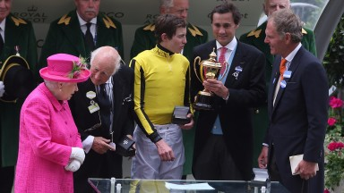 The Queen with the Gold Cup-winning team of owner Bill Gredley, jockey James Doyle, Tim Gredley and trainer Michael Bell