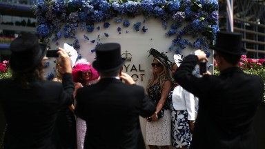Cameras out boys: the ladies pose for the lads on day four of Royal Ascot