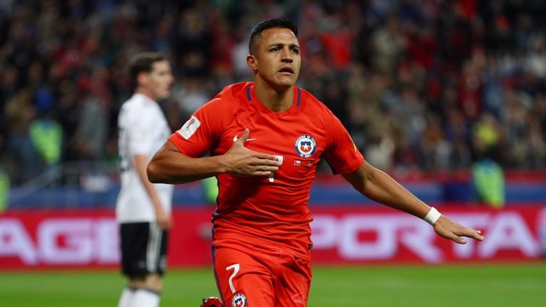 Alexis Sanchez celebrates scoring for Chile against Germany
