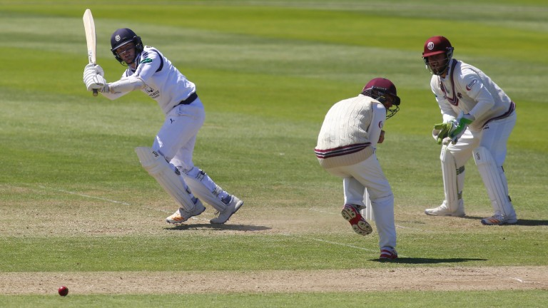 Liam Dawson of Hampshire hits out in their County Championship match against Somerset last month