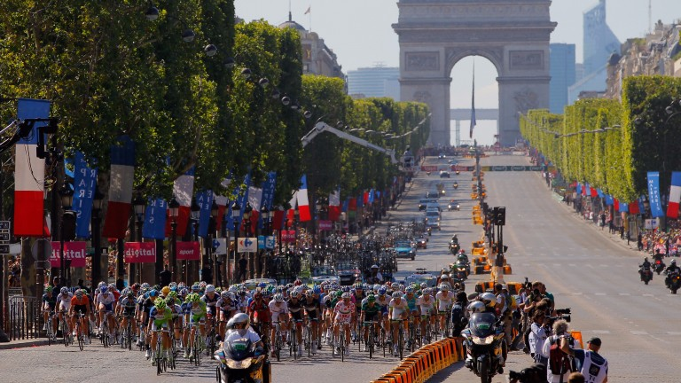 PARIS, FRANCE - JULY 22:  The peloton makes its way down the Champs-Elysees during the twentieth and final stage of the 2012 Tour de France, from Rambouillet to the Champs-Elysees on July 22, 2012 in Paris, France.  (Photo by Doug Pensinger/Getty Images)