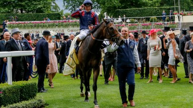 The Tin Man and Tom Queally are led in by groom Oleg Sheyhets after winning the Diamond Jubilee Stakes