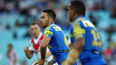 Corey Norman of the Eels moves the ball forward against the Dragons