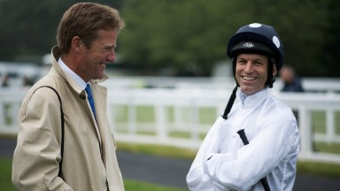 All smiles: Ralph Beckett and Pat Dobbs share a joke before winning the opener with Christopher Wood