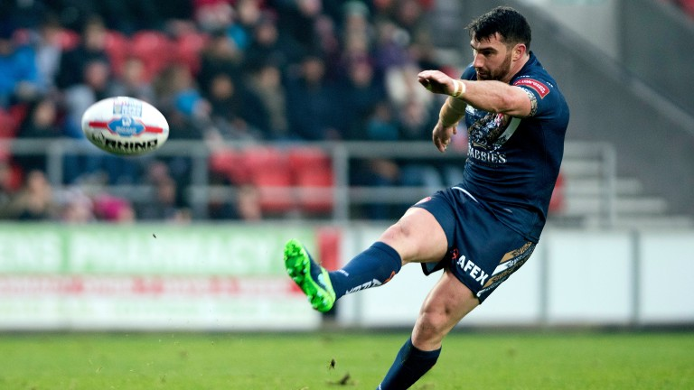Matty Smith of St Helens unleashes one of his trademark kicks