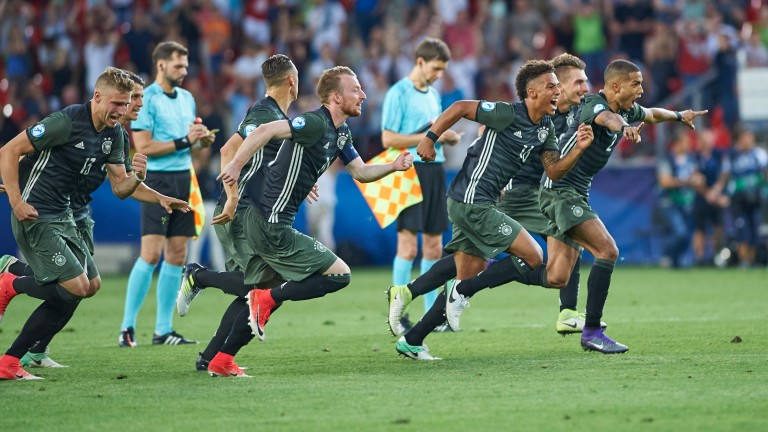 The Germany team celebrate after beating England on penalties