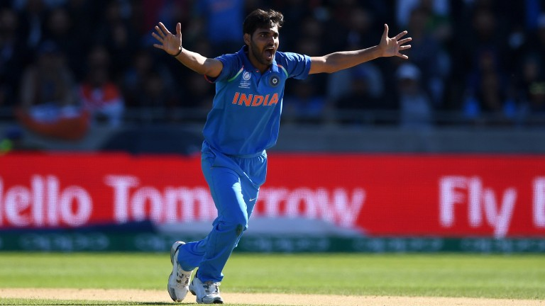 Bhuvneshwar Kumar successfully appeals for the wicket of Ahmed Shehzad in the Champions Trophy