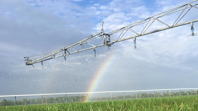 Watering using boom irrigation taking place at Brighton racecourse