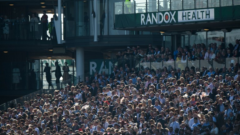 Racegoers bask in the packed standsAintree 8.4.17 Pic: Edward Whitaker
