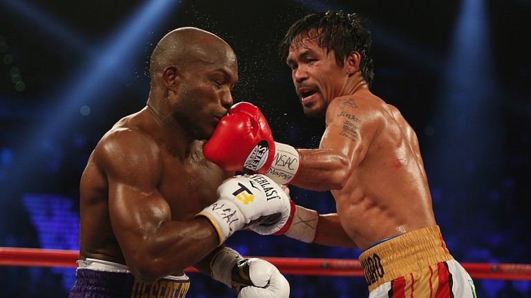 Manny Pacquiao (right) lands a left to the chin of Tim Bradley