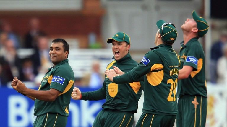 Samit Patel (left) celebrates with his teammates