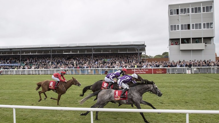 Capri (near side) holds off Cracksman (far side) and Wings Of Eagles in the Irish Derby