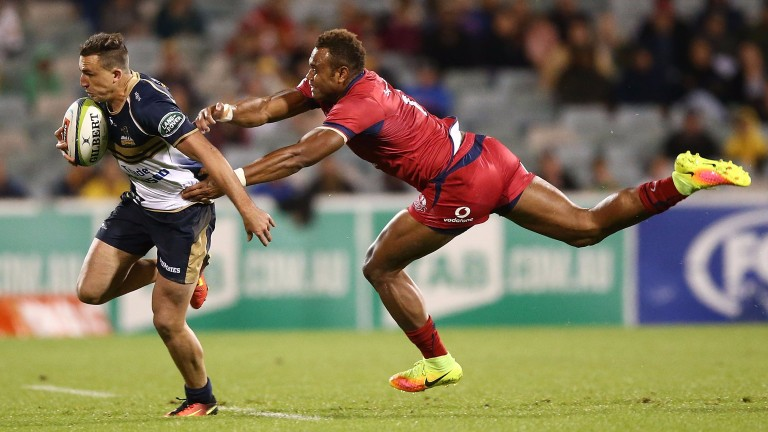 Thomas Banks of the Brumbies is tackled by Chris Kuridrani of the Reds
