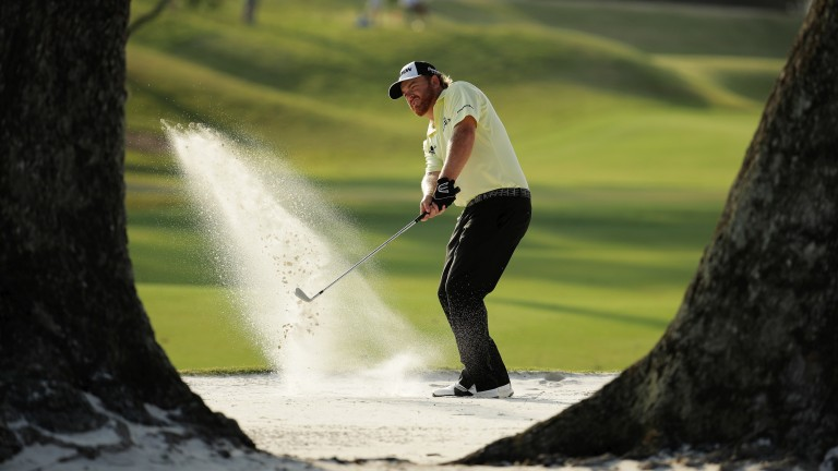 JB Holmes escapes from a bunker