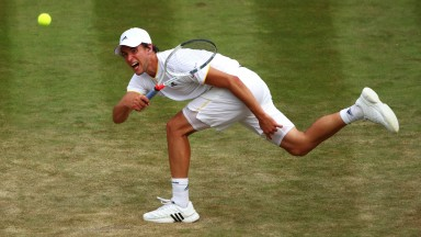 Dominic Thiem in action against Gilles Simon