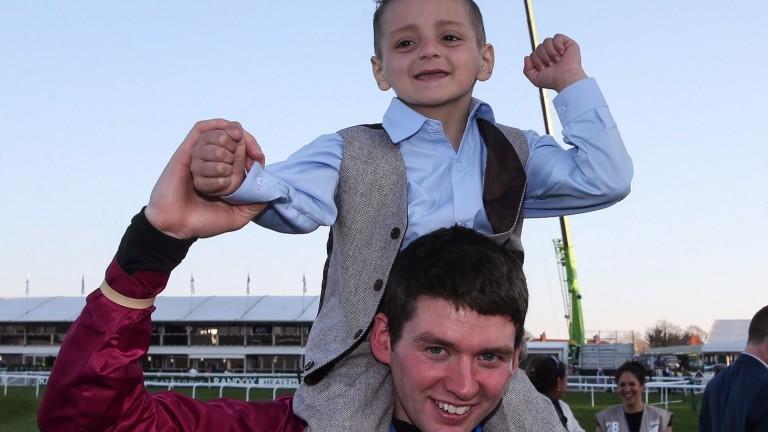 Bradley Lowery with Grand National-winning jockey Derek Fox after One For Arthur's win
