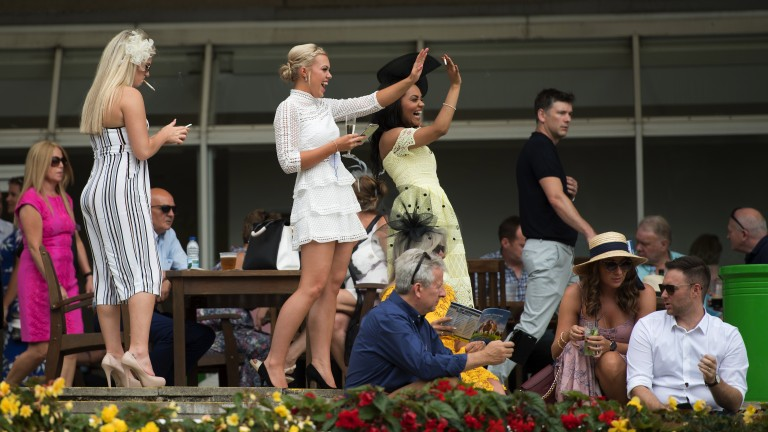 Fun in the sun: racegoers enjoy themselves on Eclipse day