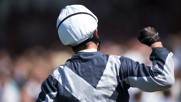 Celebration time: Jim Crowley punches the air in delight as Ulysses is called the winner