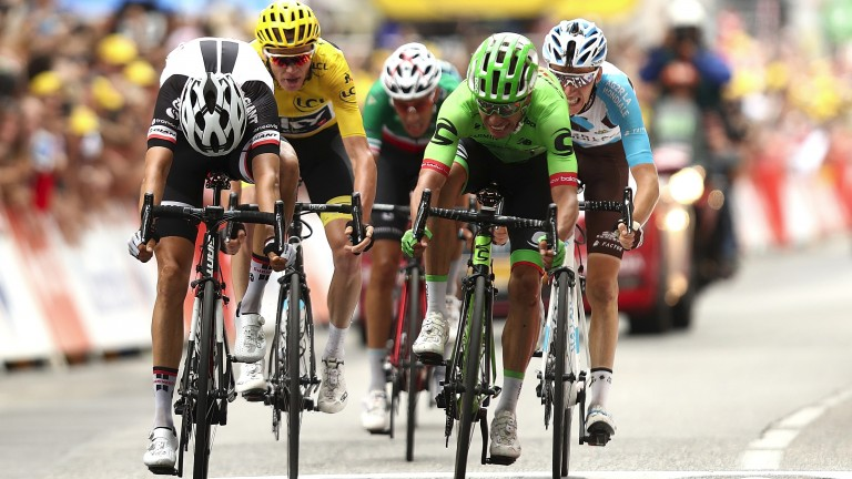 Chris Froome (yellow) finishes third to Rigoberto Uran (green) in stage nine