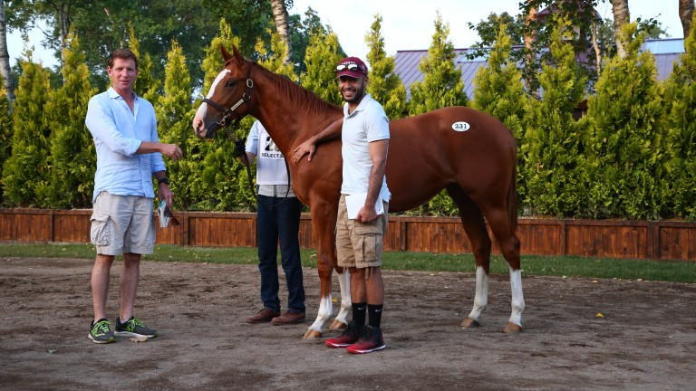 David Redvers (left) and Sheikh Fahad pose with the Harbinger filly they secured for ¥56 million
