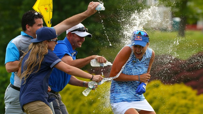 Lexi Thompson (right) is showered by well-wishers after her victory at  Kingsmill in May