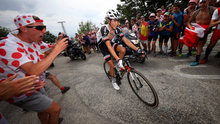 Warren Barguil is cheered on by a fan on stage nine