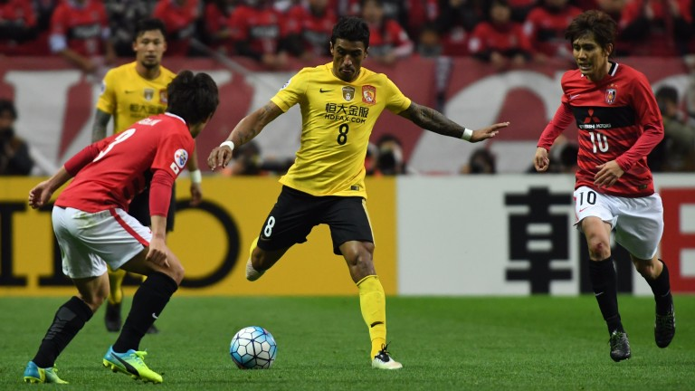 Paulinho (centre) has starred for Guangzhou Evergrande this season