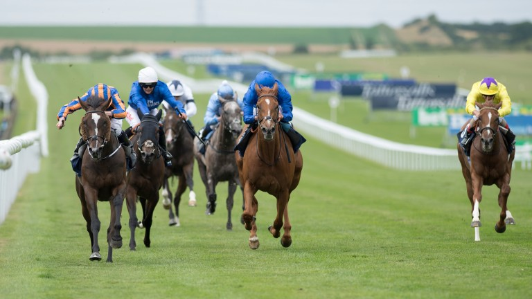 Roly Poly (Ryan Moore, left) beats Wuheida (centre) in the Falmouth Stakes
