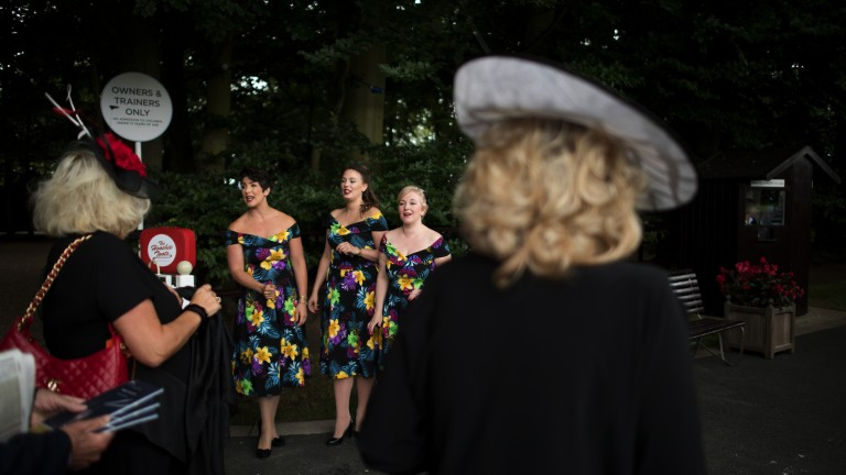 Let us entertain you: the Hoochie Toots serenade racegoers as they arrive for the second day of the July festival