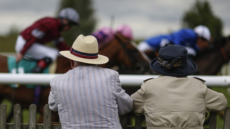 Good viewing spot: racegoers get a great vantage point watching the action on the rails