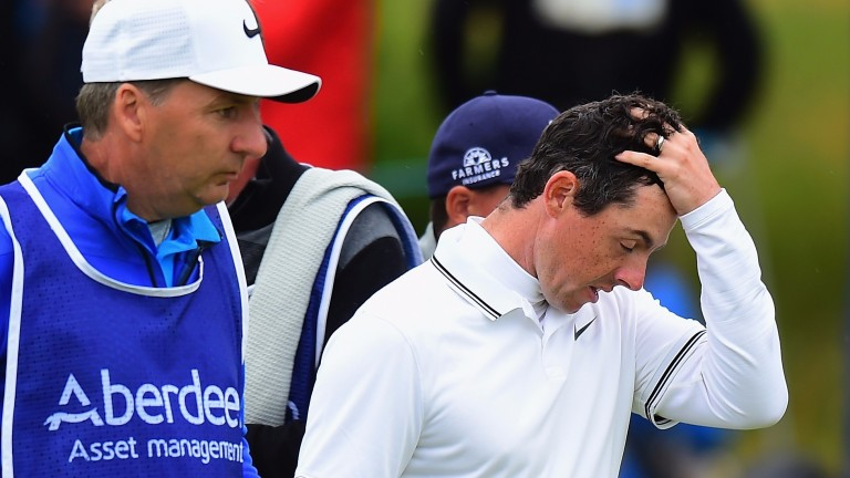 Rory McIlroy has parted company with JP Fitzgerald (left)